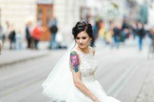 tatooed bride on urban street
