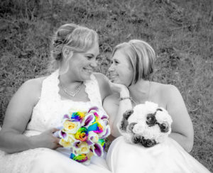 same sex wedding black and white with rainbow roses