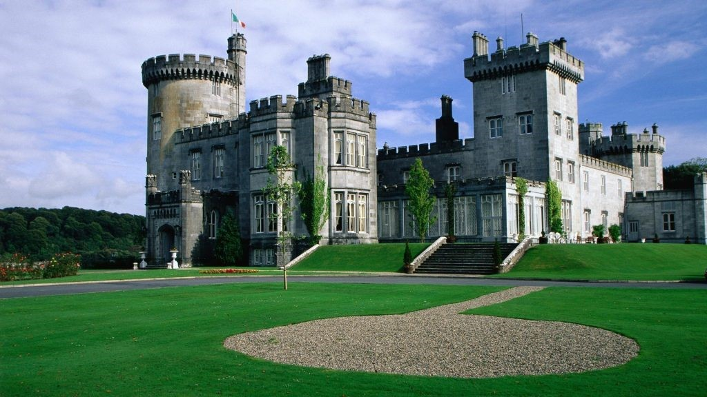 beautiful Dromoland castle in irland with green grass and golf course
