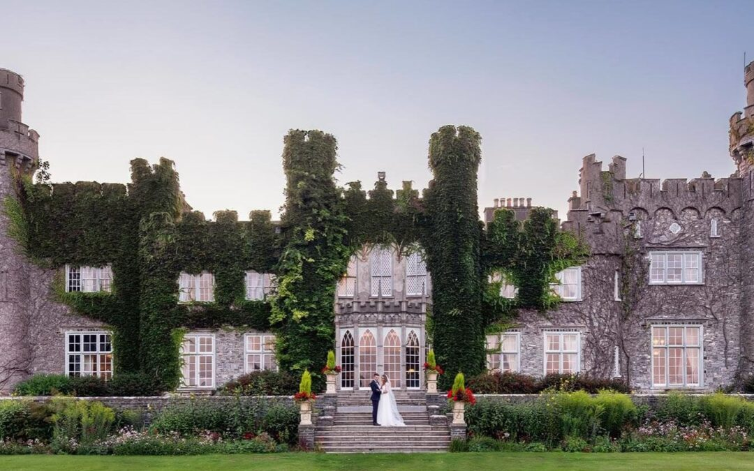 bride and groom on steps of luttrellstown castle in Ireland