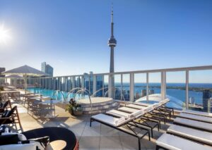 rooftop pool at kost with view of lake and CN tower