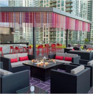 seating on rooftop at soco kitchen with pink accents